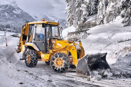 snow plow: clearing roads of snow and fallen tree