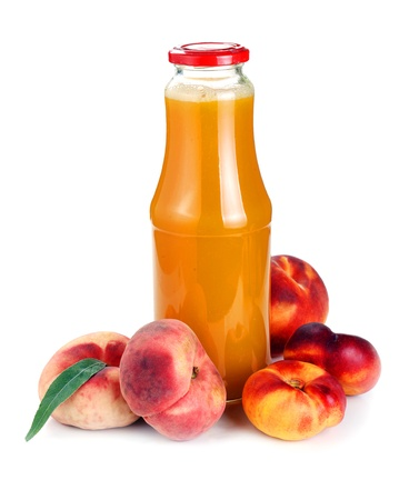 peach juice in a bottle and fruit on a white photo