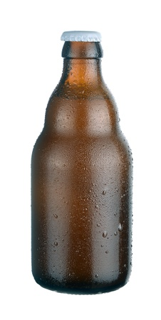 dewed: Bottle of dark  beer with drops on white background