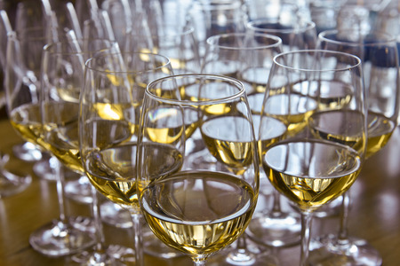 Glasses with wine on table - party background Stock Photo - 23043290