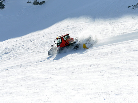 aligns snowcat ski piste in the ski resort photo