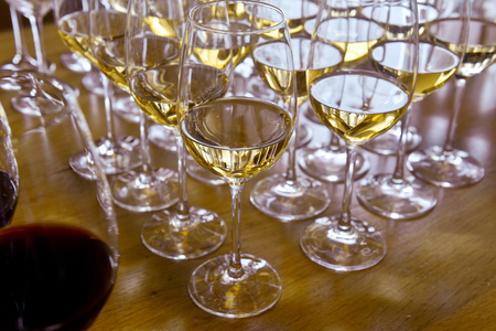 Glasses with wine on table Stock Photo - 24056096