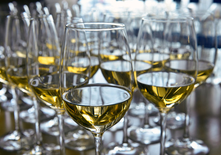 Glasses with wine on table Stock Photo - 24056122