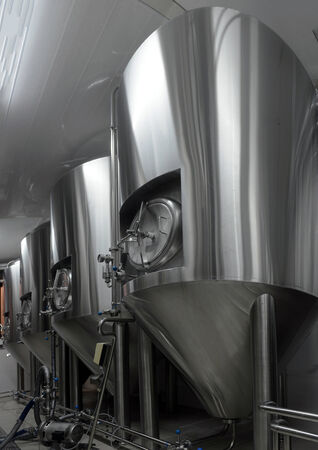 Row of tanks in microbrewery Stock Photo - 26788905