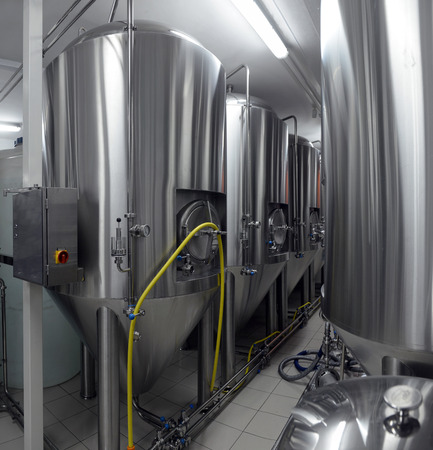 Row of tanks in microbrewery Stock Photo - 26762777