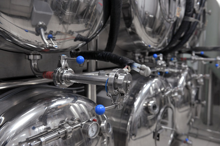 Row of tanks in microbrewery Stock Photo - 26984390