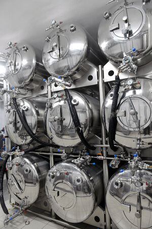 microbrewery: Row of tanks in microbrewery