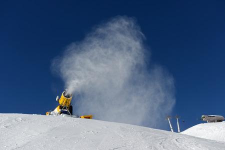 Snow cannon making snow at ski resort