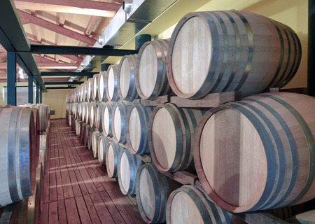 ferment: Casks in wine cellar and bottle Stock Photo