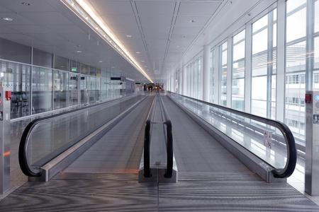 long horizontal escalator at international airport terminal