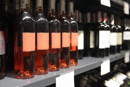 wine stocks: bottle of rose wines in the store