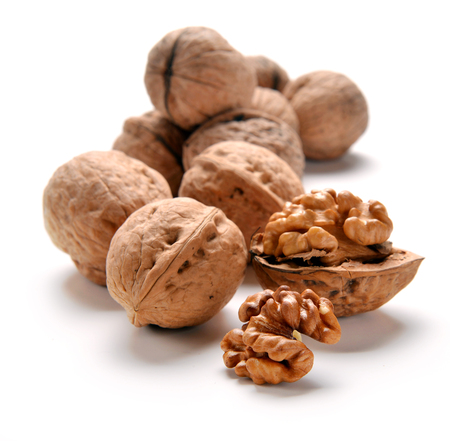 nutty: Walnuts over white backgroundg