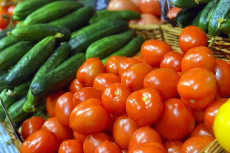 red tomatoes on display at a supermarket Stock Photo