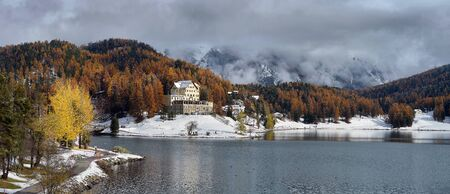 water frozen: Lake St. Moritz with the first snow in the autumn