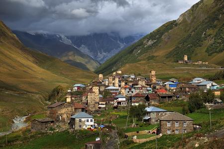 svan: Alpine village in Svaneti mountains in the background