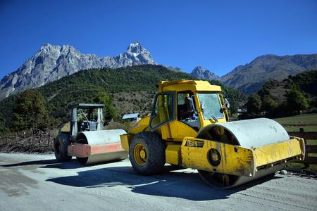 vibroroller: Heavy Vibration roller at asphalt pavement works (road repairing) Stock Photo