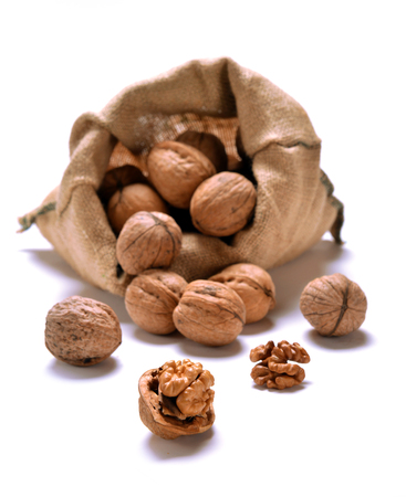 with bag: Walnuts and a bag on white