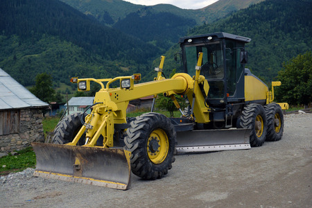 grader: Road grader - heavy earth moving road construction equipment