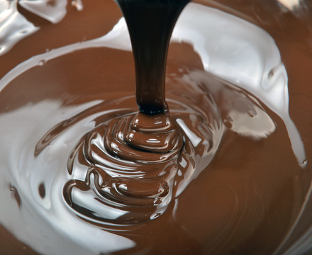 irresistible: lots of chocolate falling from above Stock Photo