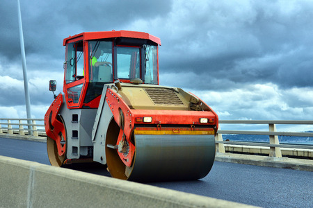 vibroroller: Heavy Vibration roller at asphalt pavement works (road repairing) Stock Photo