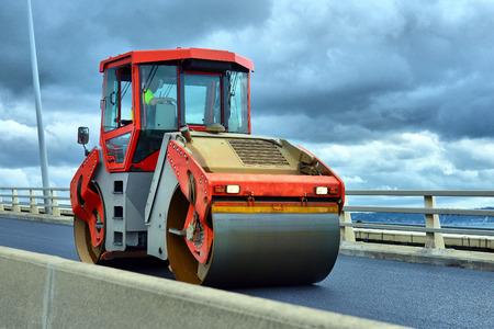 blacktopping: Heavy Vibration roller at asphalt pavement works (road repairing) Stock Photo
