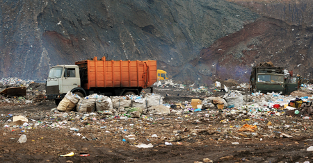 discard: Garbage truck unloading at the dump Stock Photo