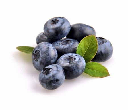 pulpy: blueberry and green leaves are on white background Stock Photo