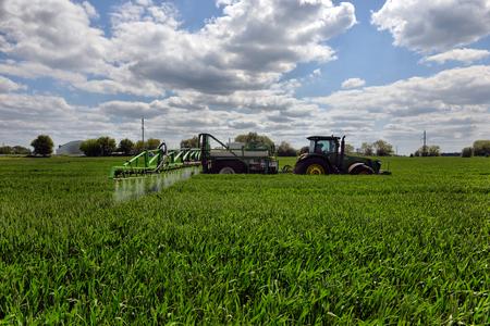 farmer wheat field spraying herbicides