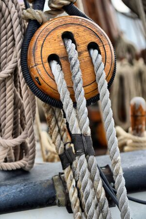 poleas: Ancient wooden sailboat pulleys and ropes detail