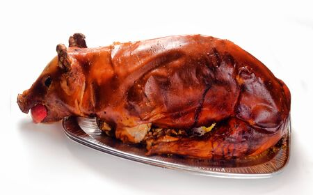 spanferkel: suckling pig roasted in the oven on a white background