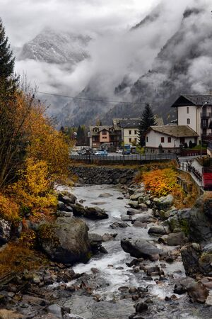 autumn landscape in the Alps with a flowing river