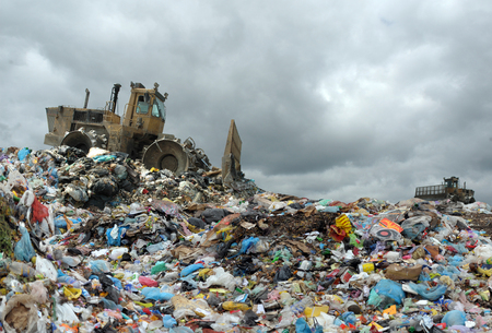 Garbage truck unloading at the dump 스톡 콘텐츠