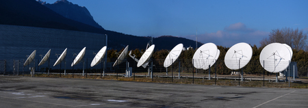 station satellite antennas in the mountains Stock Photo