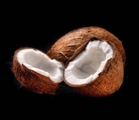 tropica: Segments of coconut on a black background Stock Photo