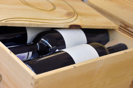 vintages: Bottle of red and white wine in wooden box Stock Photo