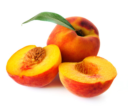 peach and leaves on a white background