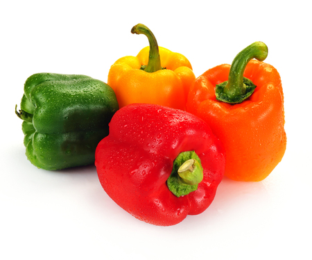 Multi-coloured paprika with water drops Stock Photo
