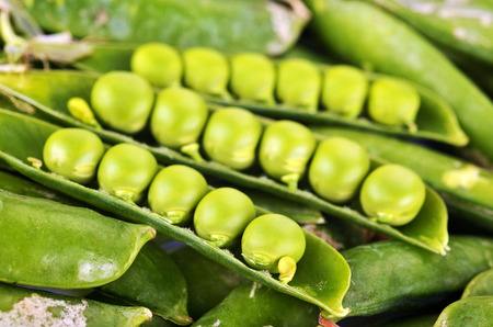 Pods of green peas isolated on a white background. Green ripe fresh vegetables. Legumes. Stock Photo