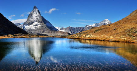 Mt Matterhorn reflected in Riffelsee Lake Zermatt Canton of Valais Switzerland 스톡 콘텐츠