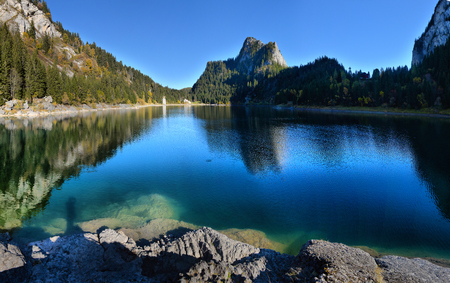 Idyllic autumn scene in the Alps with mountain lake reflection. lake in the Alps of Tanay