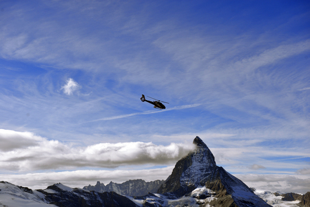 escue helicopter over the Matterhorn mountain in Switzerland