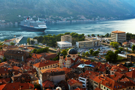 Kotor, Montenegro, 15 AUGUST 2017, Aerial View of Kotor Old Town with the Historic Orange Tiled Roof Buildings and Bay of Kotor, Kotor, Montenegro, 15 AUGUST 2017