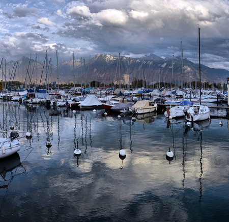 SWISS, LAKE GENEVA, 21, OCTOBER, 2017,Yachts on autumn parking lot on Lake Geneva Editorial