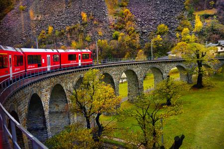 Bernina Express train, Switzerland - 01 november 2018: People sitting on the Bernina express train and admiring the scenic view on the Swiss alps; Bernina Express train, Switzerland - 01 november 2018