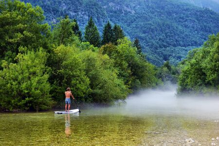 Man on a paddle Board, relax on the paddle Board, the concept of water tourism,