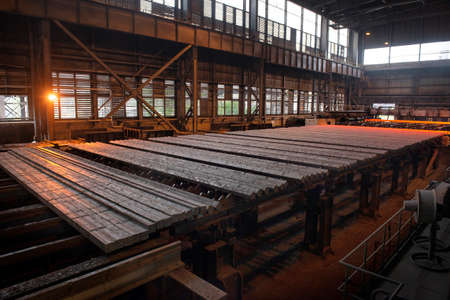 Steel production in electric furnaces. Sparks of molten steel. Electric arc furnace shop. Metallurgical production, heavy industry, engineering, steelmaking 版權商用圖片