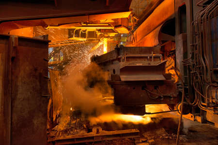 Steel production in electric furnaces. Sparks of molten steel. Electric arc furnace shop. Metallurgical production, heavy industry, engineering, steelmaking