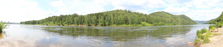 forested: Panorama of forested hills across the river