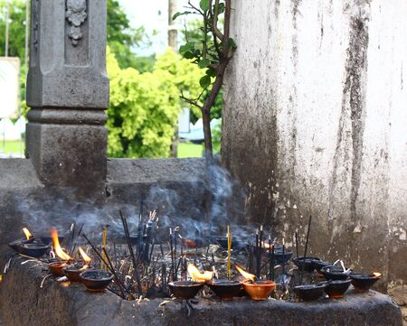 smoldering: burning incense in a Buddhist temple