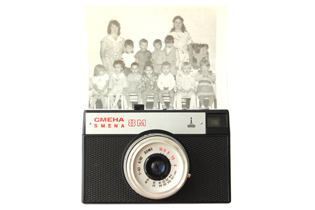 old photo: Old retro photo camera and photo of children